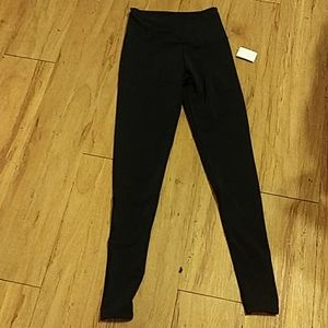 Onzie flow black leggings xs nwt flaw